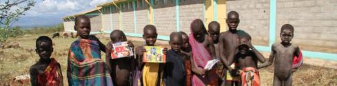 Progress greeting children of Omo Valley (Courtesy of Ethiopian Sugar Corporation)