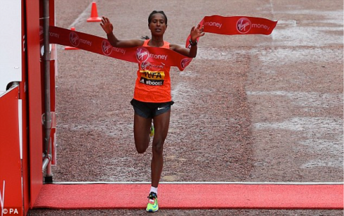 Ethiopia's Tigist Tufa breaks the tape to win the Women's Elite Race in the Virgin Money London Marathon (MailOnline)