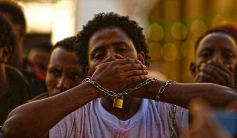 Ethiopian migrants, all members of the Oromo community of Ethiopia living in Malta, protest against the Ethiopian regime in Valletta, Malta, December 21, 2015. REUTERS/Darrin Zammit Lupi