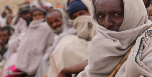 People wait for food aid at a distribution centre in northern Ethiopia. The aid is becoming ever more important as the drought rages on, leaving more than ten million Ethiopians vulnerable to food shortages. (Ellen Mauro (CBC News )