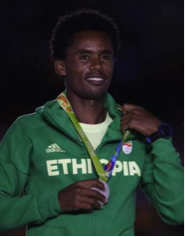 The Ethiopian hero Feyisa Lelisa with his award at Rio