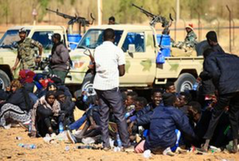 People from Somalia and Ethiopia are detained on the outskirts of Khartoum in January 2017. Activists say Sudan's crackdown on migrants and refugees has escalated. Photograph: Ashraf Shazly/AFP/Getty Images